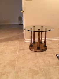 Round glass top and brown brass based side/coffee table- Cash only Monmouth Junction, 08852