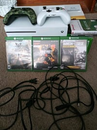 Xbox One console with controller and game cases Columbus, 43219