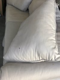 White fabric padded sofa chair