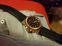 round gold chronograph watch with black leather strap Longueuil, J4M 1H6