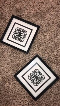 two black wooden photo frames 52 km