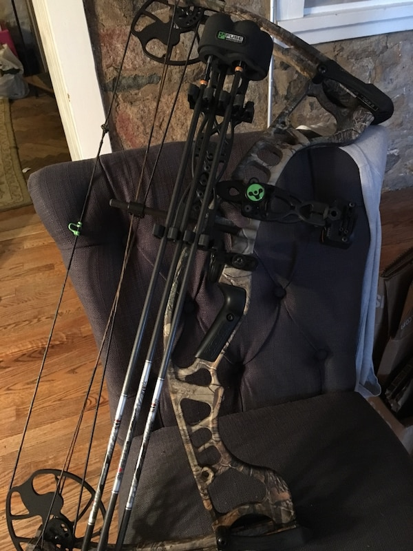 Beige, brown, and black compound bow