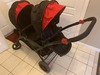 baby's black and red stroller Mississauga, L5N 7Z9