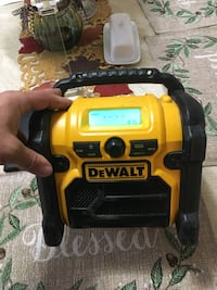 Dewalt radio, cell phone compartment with aux hook up for phone or iPod. Works perfect, battery powered or work off electricity. Accepts 12, 20 or 18 volt batteries. Newark, 94560