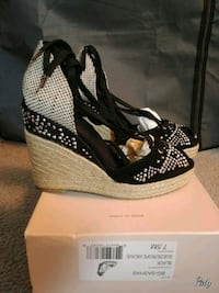 pair of black open toe ankle strap wedges 1210 mi