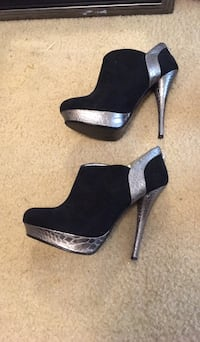 pair of black leather peep-toe platform stilettos