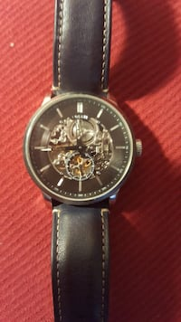 round silver chronograph watch with black leather  London, N6H 5H2