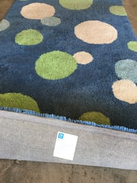 Blue, green, and white area rug