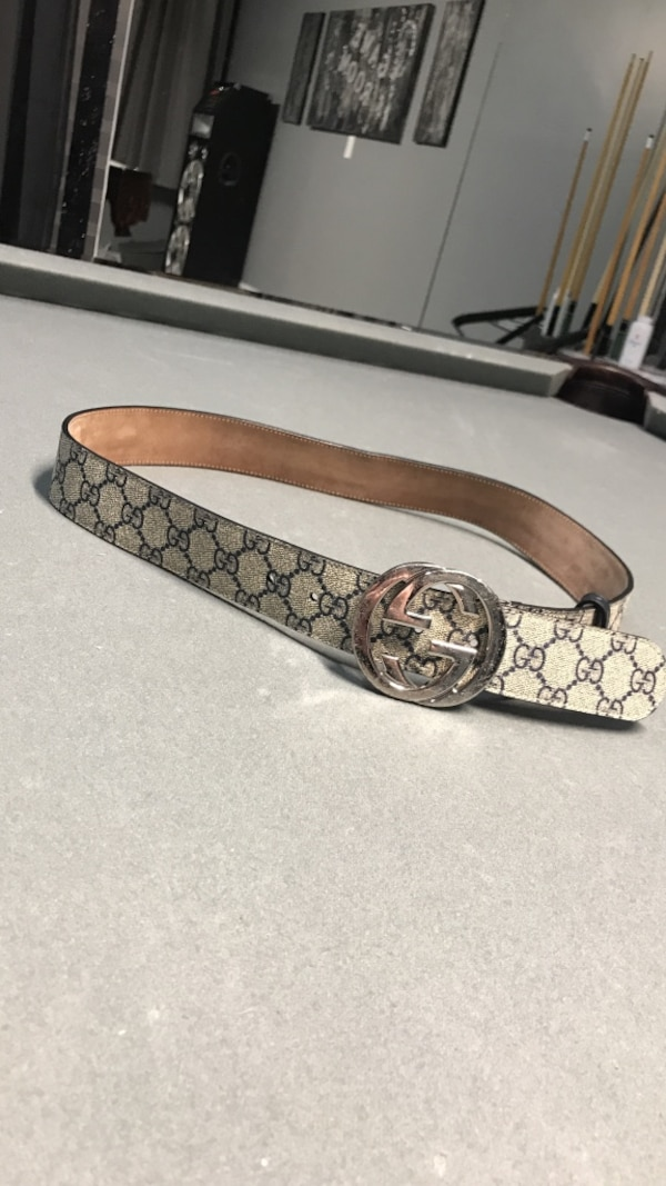 Monogrammed black and beige gucci leather buckle bel