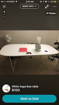 white and black wooden table London, N5X 2W8