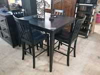 black high top table with chairs