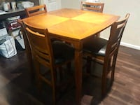 rectangular brown wooden table with six chairs din Cypress, 77433