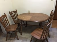 Round brown wooden table with four chairs dining set Mississauga, L5B 1E9