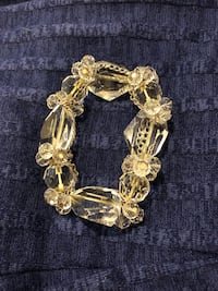 Vintage Crystal Bracelet Fashion Jewelry...Clear..This is handmade locally... Purchased from a Hallmark Shop..This is preowned in EGC..Fits up to plus size.. Stretches..There are a couple nicks not noticeable.. Virginia Beach, 23451
