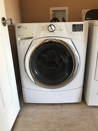 white Whirlpool front-load laundry machine