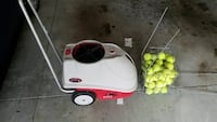 gray and red tennis pitching machine