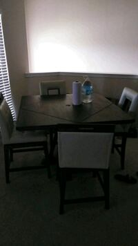 rectangular brown wooden table with chairs dining set Houston, 77070