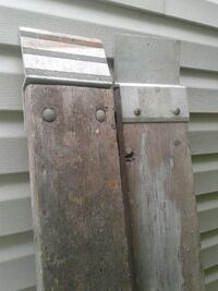 two brown wooden planks with metal attachment Dundalk, 21222
