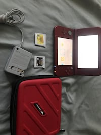 black Nintendo 3DS with game cartridges Gaithersburg, 20877