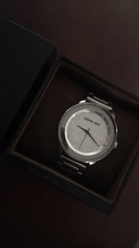 round silver analog watch with black leather strap Laval, H7P 0B6