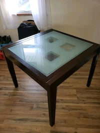Glass top expandable dining room table.  New Windsor
