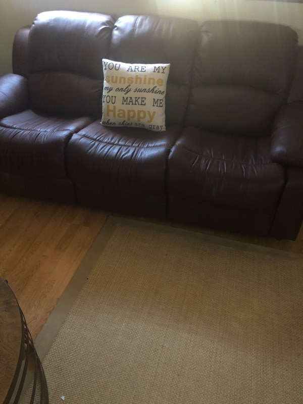 Brown faux leather couch with sofa bed