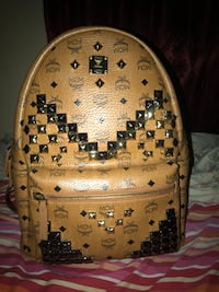 brown and black MCM leather backpack