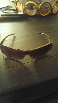 brown framed sunglasses with case 3734 km