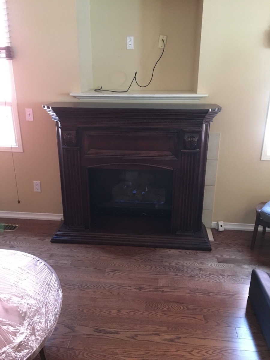 Brown wooden framed fireplace - Pickering