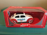 red and white Coca-Cola Volkswagen Beetle die-cast model