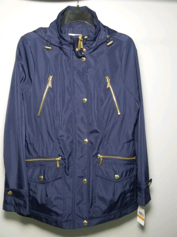 Michael Kors rain coat. Size S. Navy blue. New with tags. Retail $220. b33de7fc-9b80-4aec-a3d9-334e724ce8e9