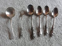 5 spoons and 1 little fork real silverware Gulfport, 33707