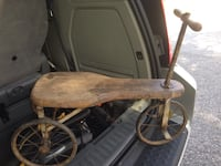 brown wooden trike
