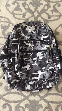 white, gray, and black camouflage Trans (Jansport) backpack