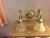 Two brass and white  wall mount uplight chandelier Baltimore, 21211