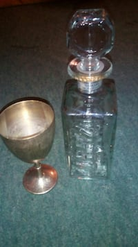 clear glass decanter with glass stopper and brass chalice