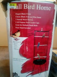 Tall bird cage on a stand never used brand new .