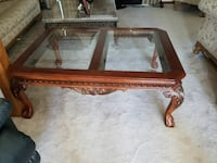 rectangular brown wooden framed glass-top coffee table