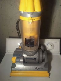 gray and yellow Dyson upright vacuum cleaner Edmonton, T5W 2B3