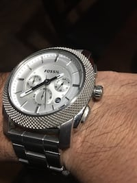 Round silver fossil chronograph watch with link bracelet