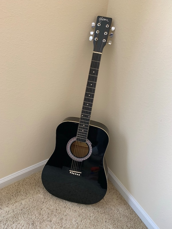 Black Acoustic Guitar with Carrying Case and Beginner's Instruction Manual