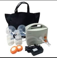 white and orange breast pump with bag