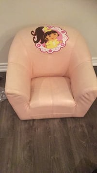 white leather sofa chair with pink floral throw pillow Vaughan, L6A 4M5
