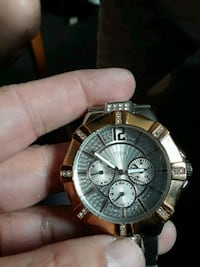 round silver-colored chronograph watch with link b Winnipeg, R3A 0G3