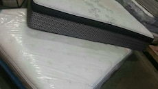 white bed mattress in package