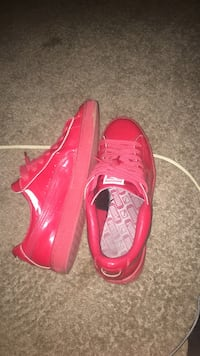 Pair of red puma sneakers size 9 in men