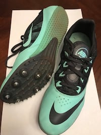 pair of black-and-green Nike cleats Fontana, 92335