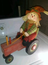 New Scarecrow on Wooden Tractor