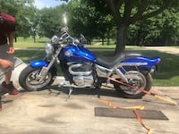 blue and black touring motorcycle 614 mi