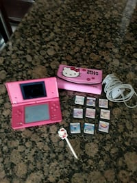 pink Nintendo DS with game cartridges Fresno, 93704